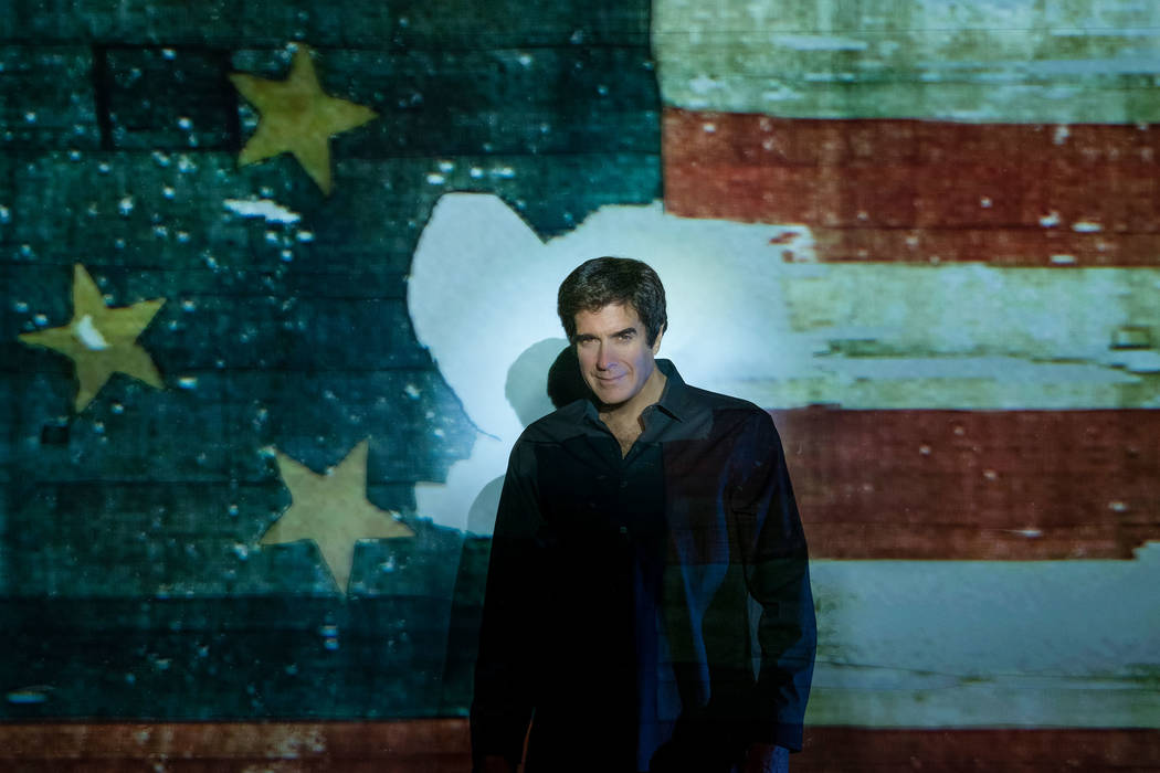 Magic legend David Copperfield is shown with an image of the original Star-Spangled Banner at t ...