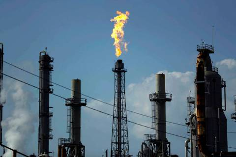 In this Thursday, Aug. 31, 2017, file photo, a flame burns at the Shell Deer Park oil refinery ...