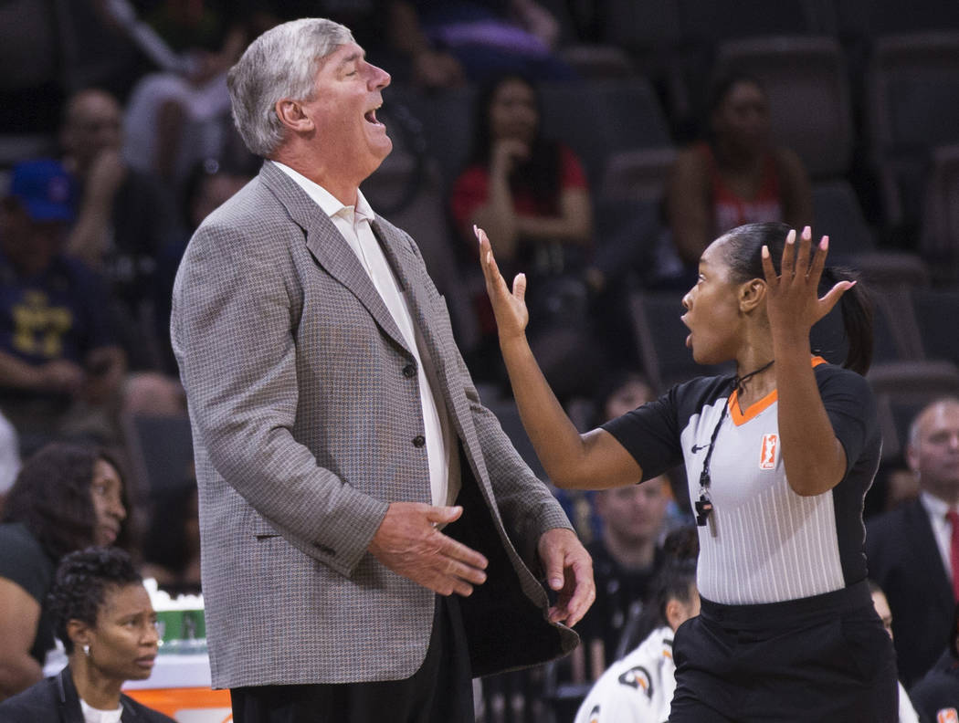 Las Vegas Aces head coach Bill Laimbeer, left, argues a call in the second quarter during Vegas ...