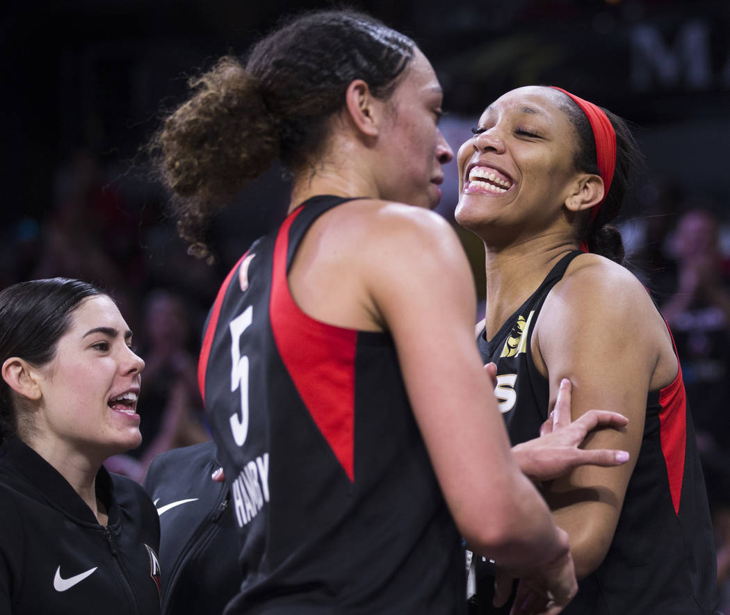 Las Vegas Aces center A'ja Wilson (22) celebrates with Las Vegas Aces forward Dearica Hamby (5) ...