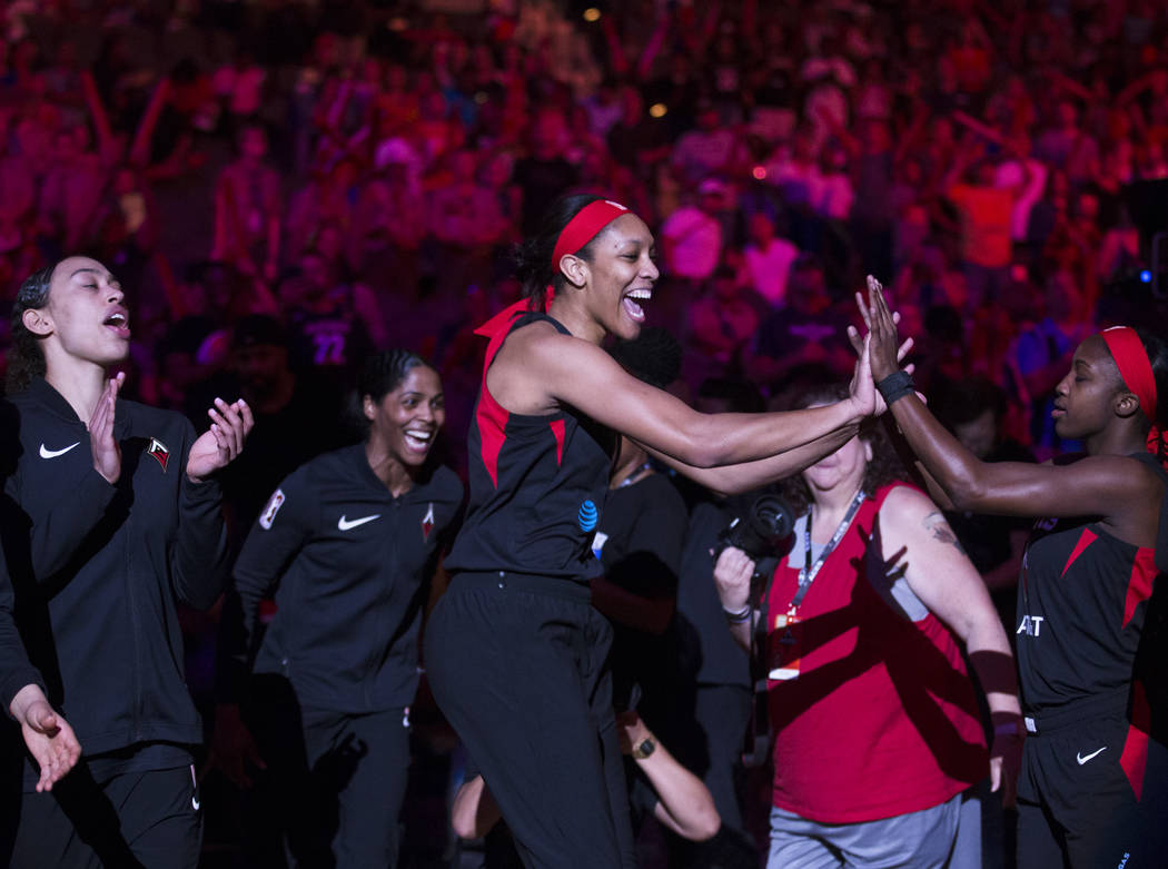 Las Vegas Aces center A'ja Wilson (22) is announced before the start of Vegas' WNBA game with t ...