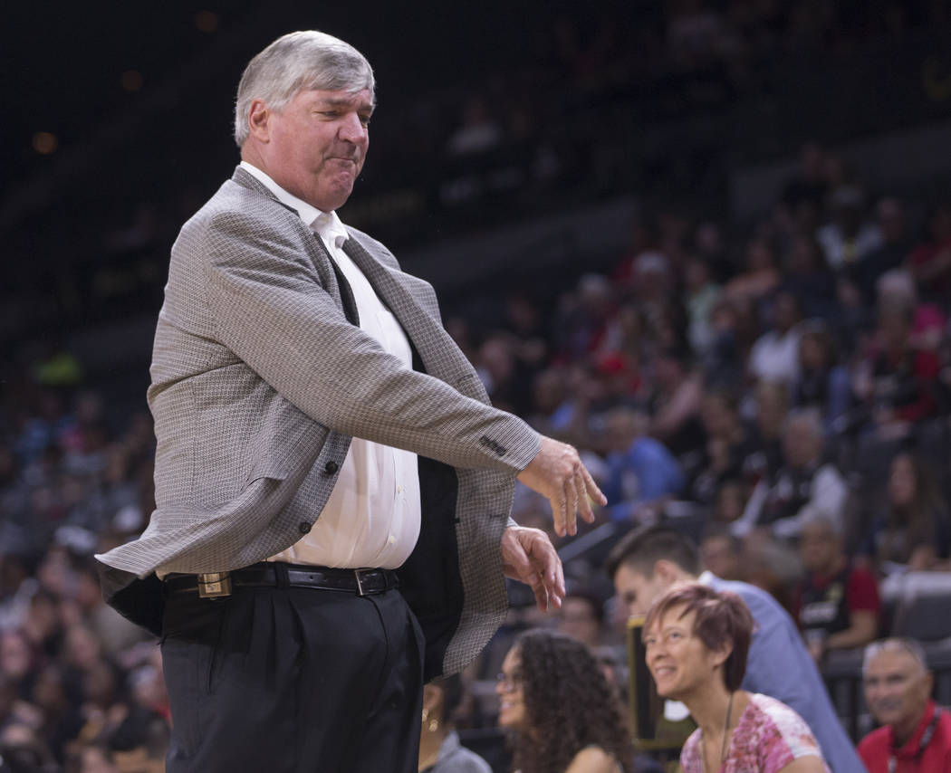 Las Vegas Aces head coach Bill Laimbeer throws a cup after getting a technical foul in the four ...