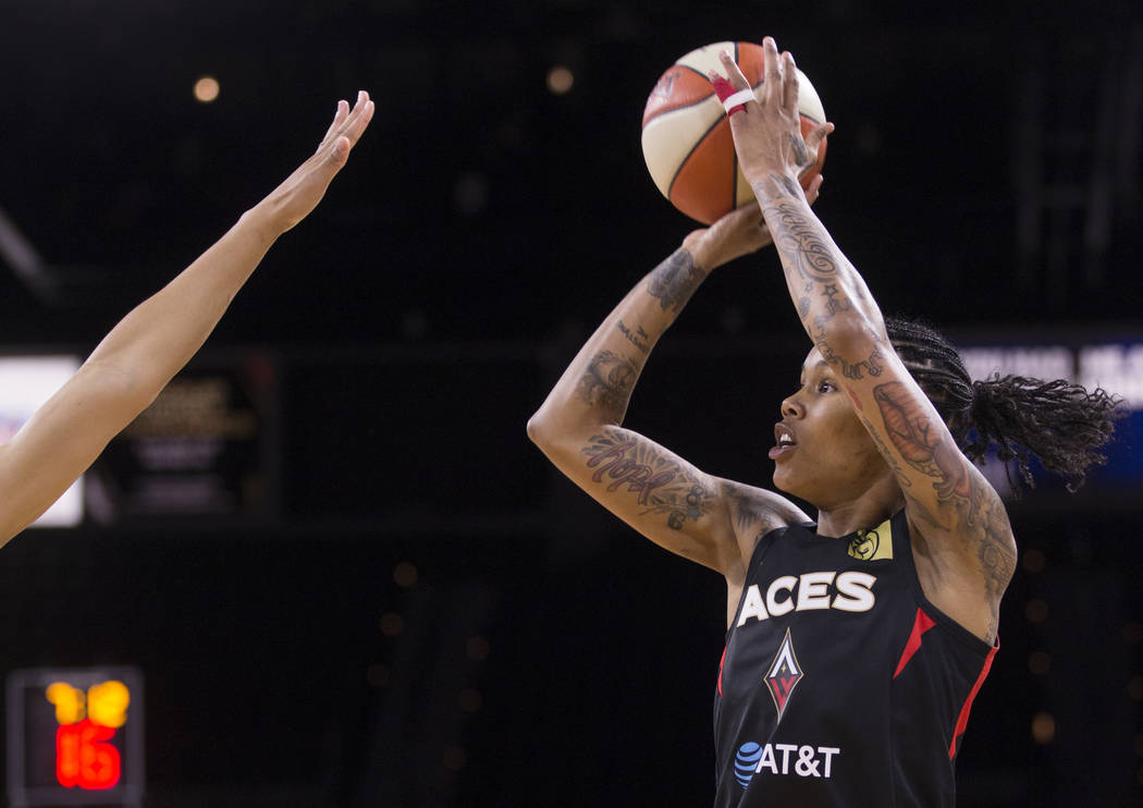 Las Vegas Aces forward Tamera Young (1) shoots a corner three point shot over a Dallas Wings de ...
