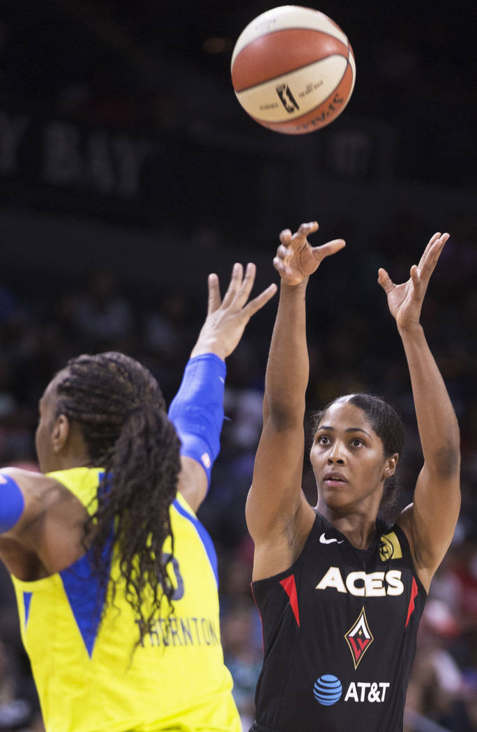 Las Vegas Aces guard Sydney Colson (51) shoots a jump shot over Dallas Wings forward Kayla Thor ...