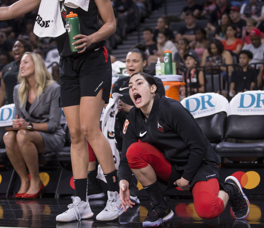 Las Vegas Aces guard Kelsey Plum (10) cheers for her teammates in the fourth quarter during the ...