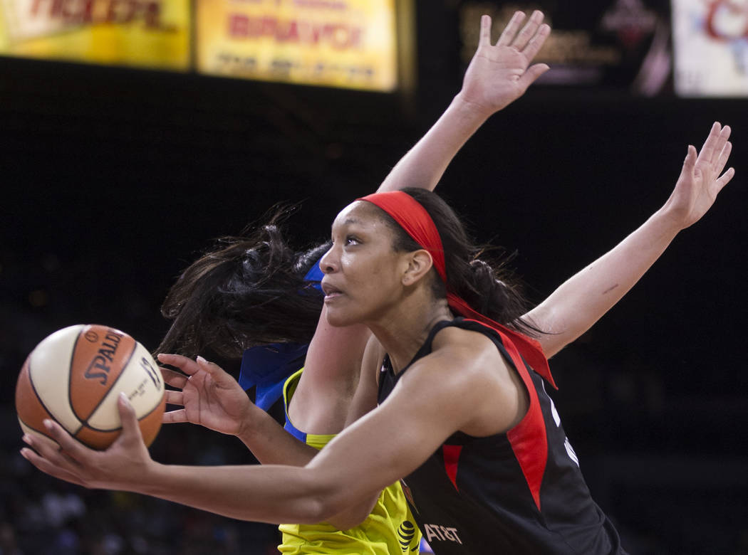Las Vegas Aces center A'ja Wilson (22) slices to the rim past Dallas Wings forward Megan Gustaf ...