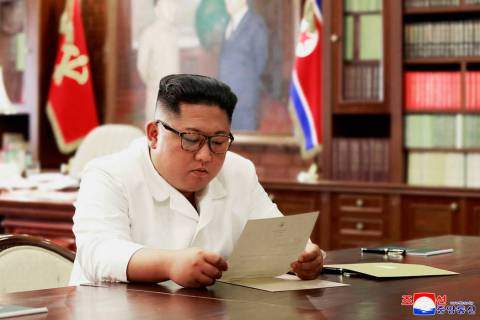 INorth Korean leader Kim Jong Un reads a letter from President Donald Trump. Independent journa ...