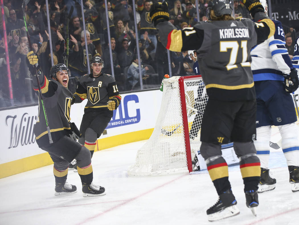 Golden Knights center Jonathan Marchessault, left, celebrates a goal by Golden Knights center W ...