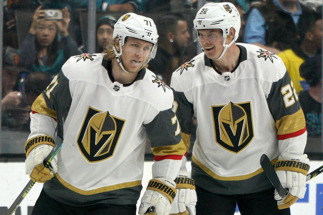 Vegas Golden Knights center William Karlsson (71) is congratulated by teammate Nick Holden (22) ...