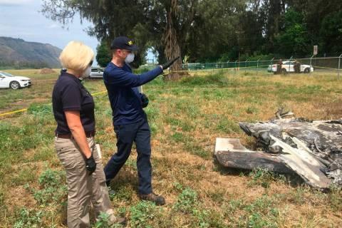 NTSB investigator Eliott Simpson briefs NTSB Board Member Jennifer Homendy at the scene of the ...