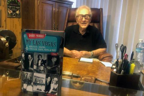 "Legendary Las Vegas drummer Bobby Morris is shown with his new autobiography, ""My Las Vegas,"" i ..."