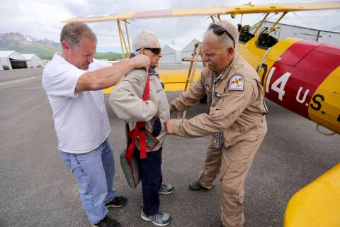 In this June 14, 2019, photo Dane Wilkinson, left, and Doug Compton, right, help retired Air Fo ...