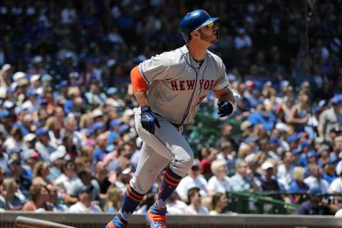 New York Mets' Pete Alonso watches after hitting a solo home run against the Chicago Cubs durin ...
