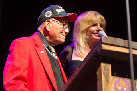 Actress Loni Anderson receives the Millie Taylor award from Lt. Col. Bob Friend, the oldest liv ...