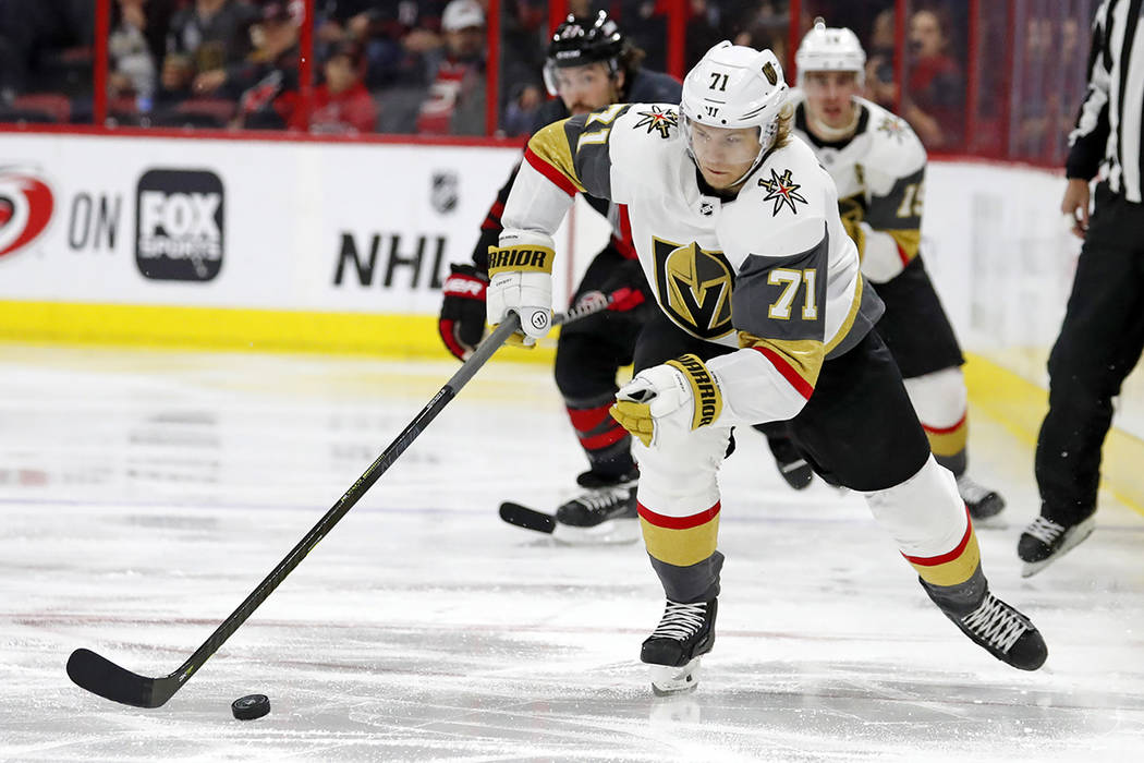 Vegas Golden Knights' William Karlsson (71) brings the puck up the ice against the Carolina Hur ...