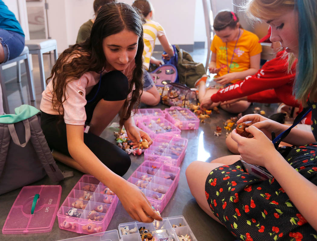Eva Tonella, 12, of San Francisco, left, and Megan Diesing, 13, of Portland, Ore., check Little ...