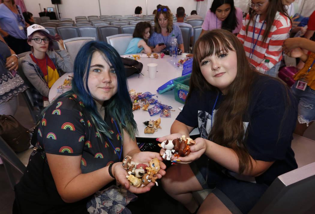 Laila Pittman, 11, of Illinois, left, and Elyse Despain, 12, of St. George, Utah show their Lit ...