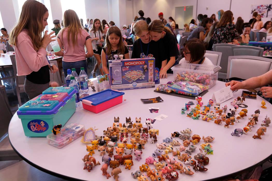 Attendees trade Littlest Pet Shop dolls during LPSCon West Coast at MEET Las Vegas, Sunday, Jun ...