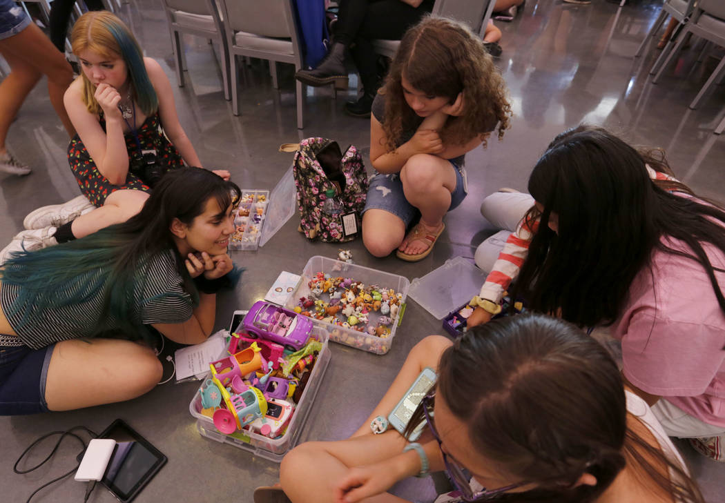 Angelica Sanchez, 17, of Los Angeles, foreground left, shows her Littlest Pet Shop collection t ...