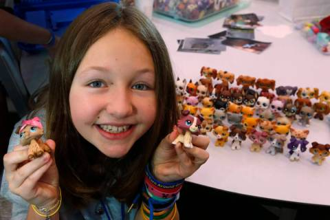 Lila Turner, 11, of Austin, Texas shows her Littlest Pet Shop collection during LPSCon West Coa ...