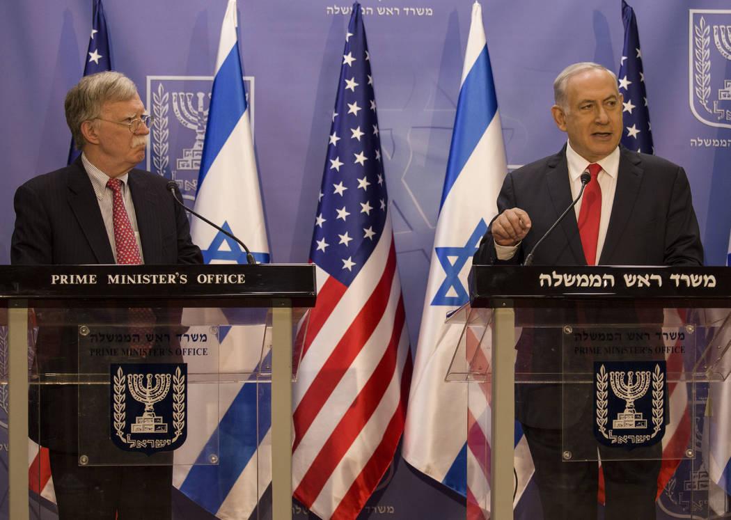 Israeli Prime Minister Benjamin Netanyahu, right, U.S. National Security Advisor John Bolton gi ...