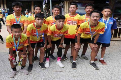 Members of the Wild Boars soccer team who were rescued from a flooded cave, pose for the media ...