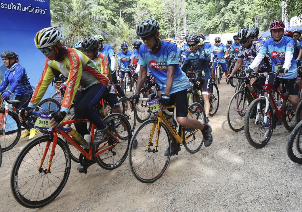 Participants start during a marathon and biking event in Mae Sai, Chiang Rai province, Thailand ...