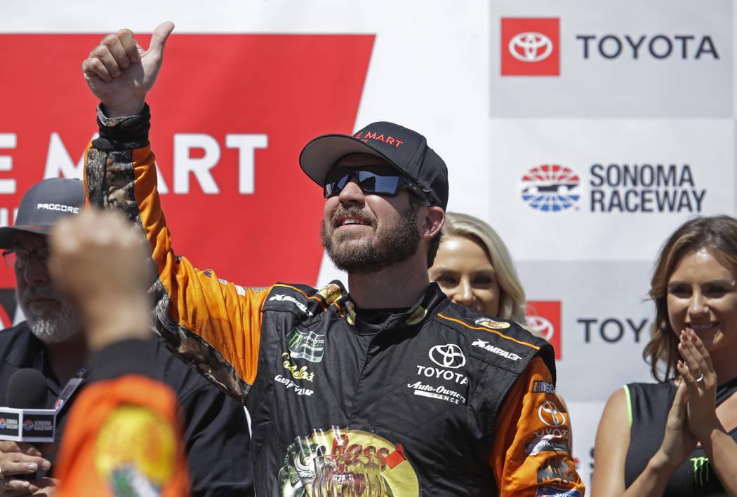 Martin Truex Jr. celebrates after winning a NASCAR Sprint Cup Series auto race Sunday, June 23, ...