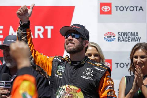 Martin Truex Jr. celebrates after winning a NASCAR Sprint Cup Series auto race Sunday, June 23, ...
