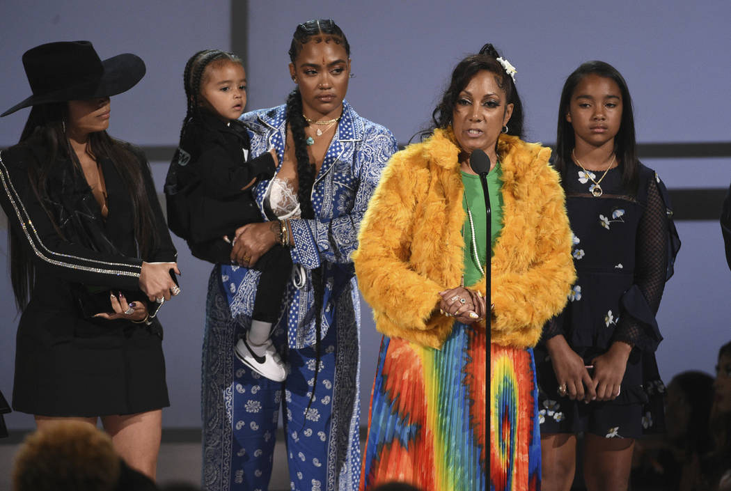 Angelique Smith, mother of late rapper Nipsey Hussle, accepts the humanitarian award on behalf ...