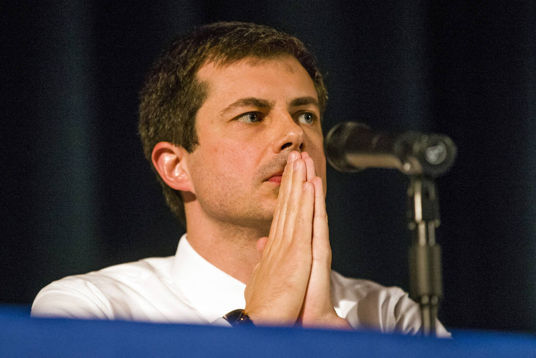 Democratic presidential candidate and South Bend Mayor Pete Buttigieg looks on during a town ha ...