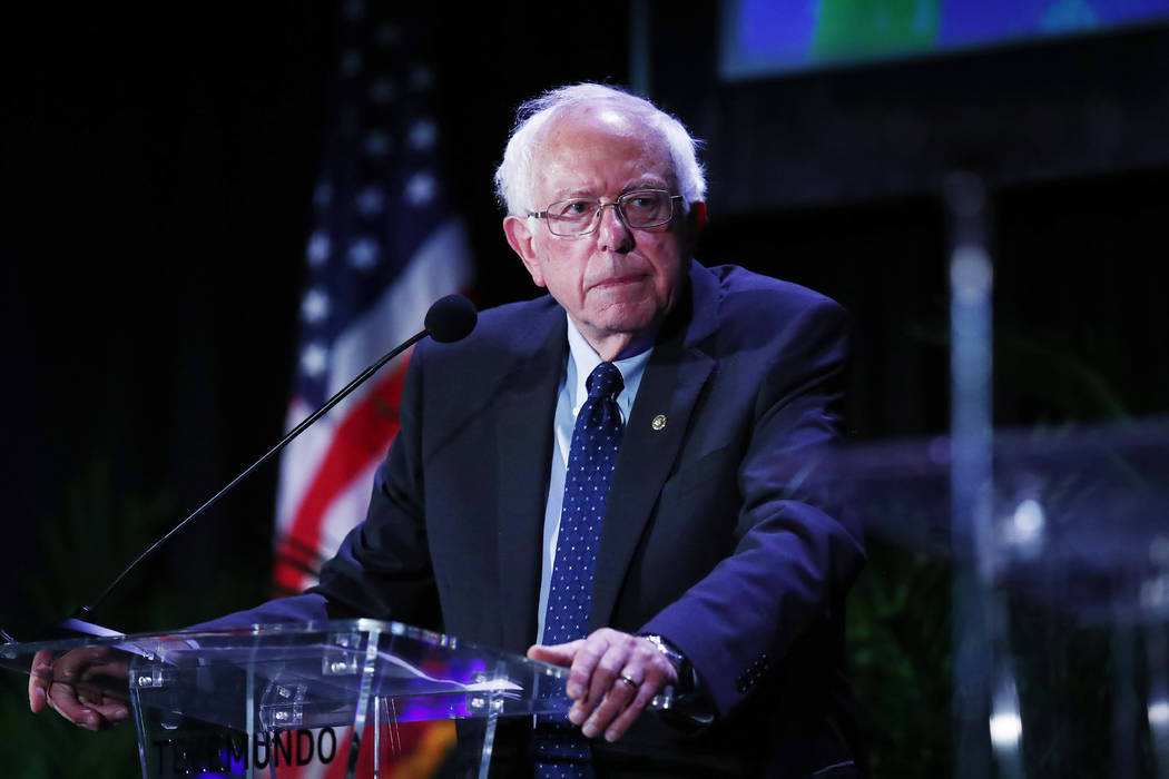 Democratic presidential candidate Sen. Bernie Sanders, I-Vt., pauses while speaking during a fo ...