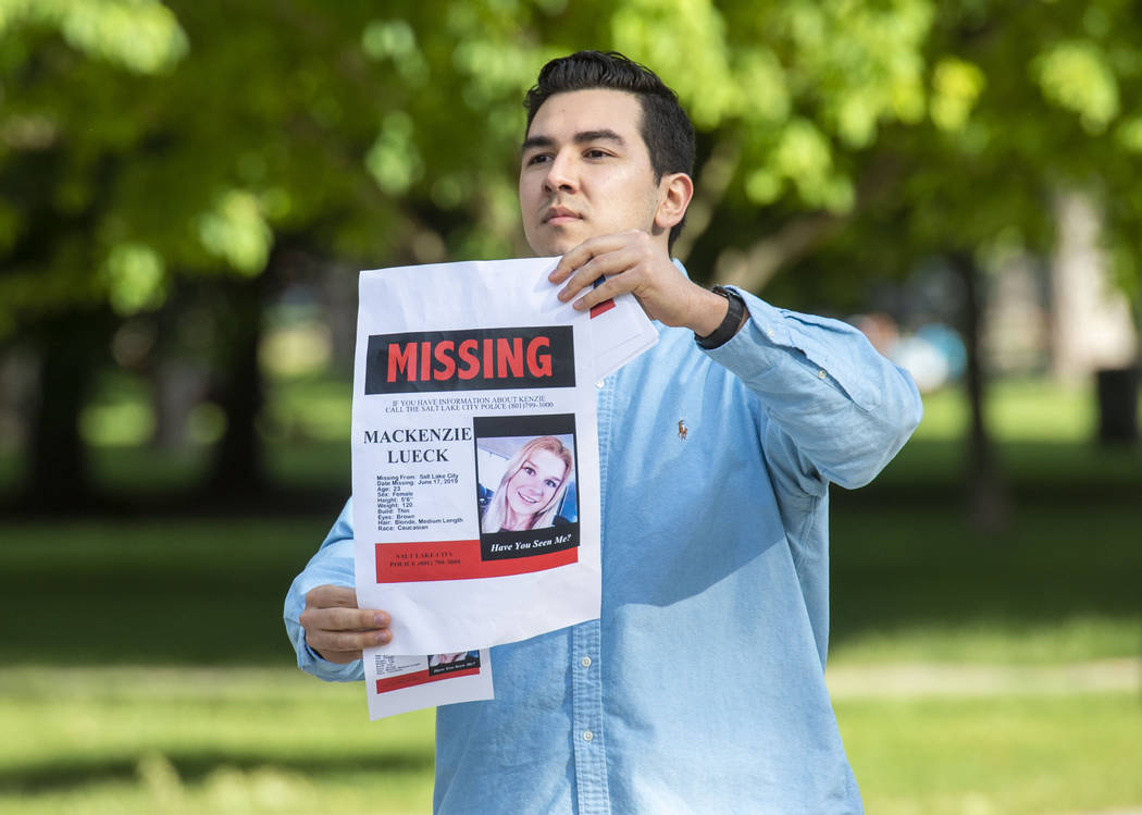 In this Saturday, June 22, 2019 photo, Nate Crispo holds a holds a sign with Mackenzie Lueck's ...