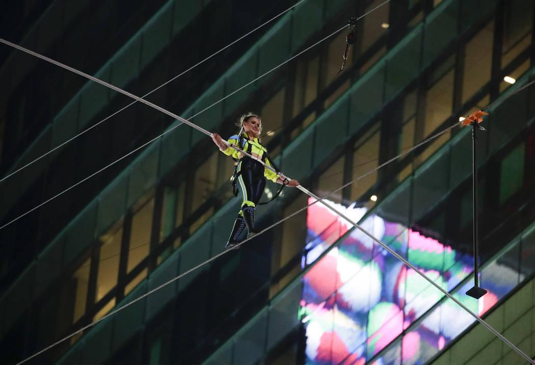Aerialist Lijana Wallenda walks on a high wire above Times Square, Sunday, June 23, 2019, in Ne ...