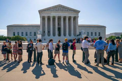 Visitors line up to enter the Supreme Court on Capitol Hill in Washington, Monday, June 24, 201 ...