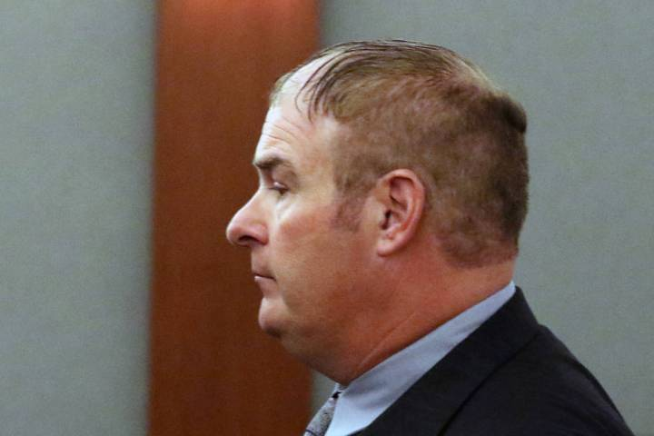 A former Las Vegas Fire Capt. Richard Loughry leaves the courtroom at the Regional Justice Cent ...