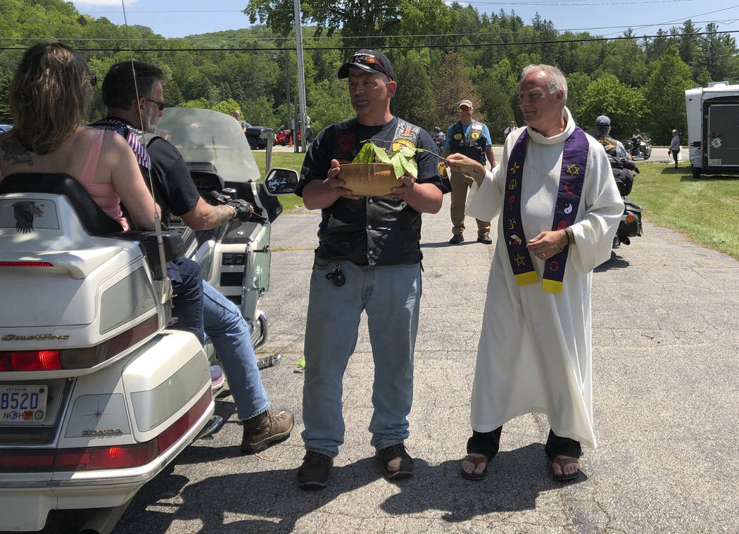 """Motorcyclists participate in a """"Blessing of the Bikes"""" ceremony in Columbia, N.H., Su ..."""