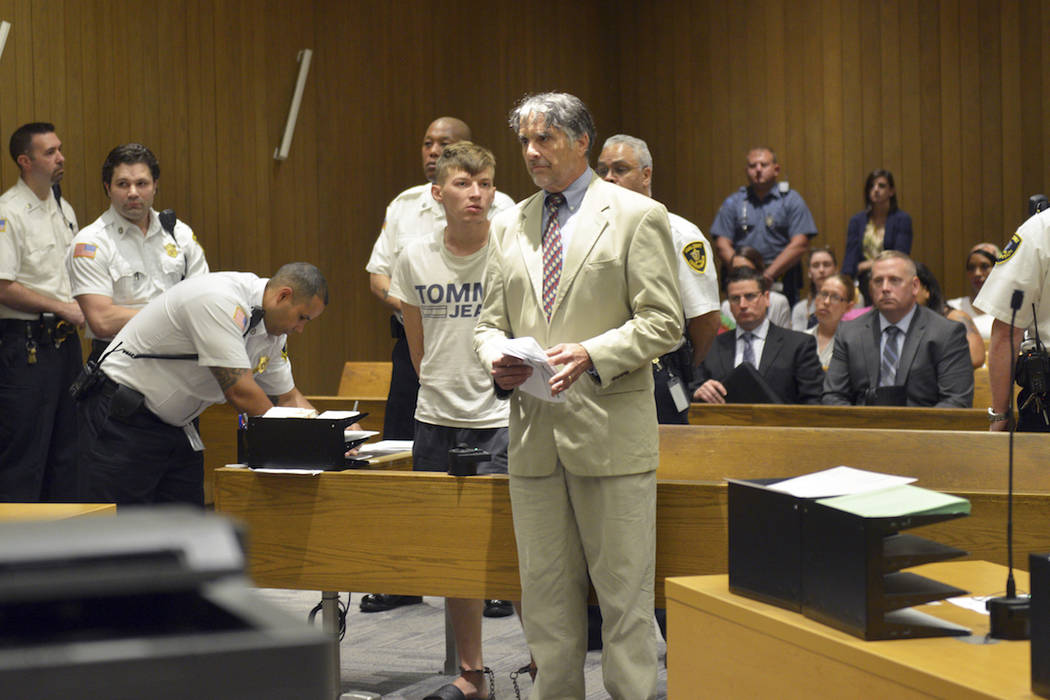 Volodymyr Zhukovskyy of West Springfield stands while his attorney Donald Frank speaks during h ...