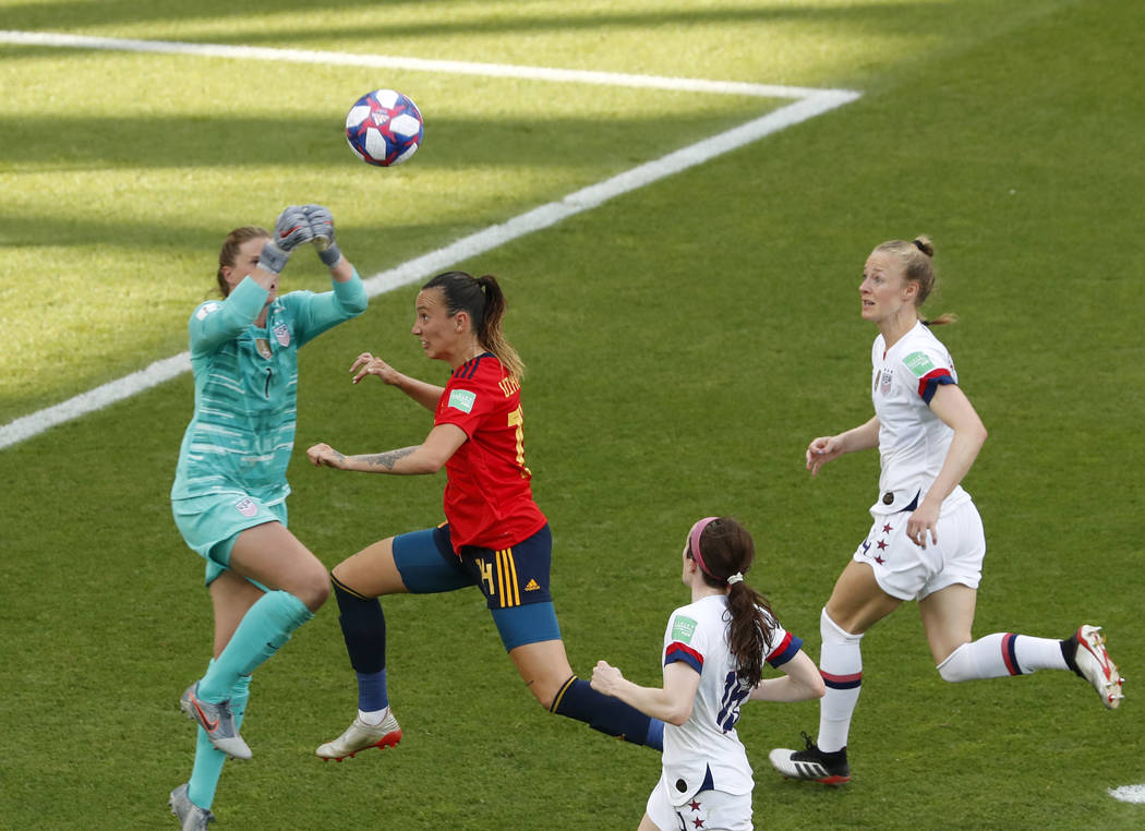 United States goalkeeper Alyssa Naeher, left, makes a save in front of Spain's Virginia Torreci ...
