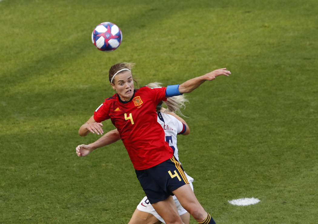 Spain's Irene Paredes, front, duels for the ball with United States' Julie Ertz during the Wome ...