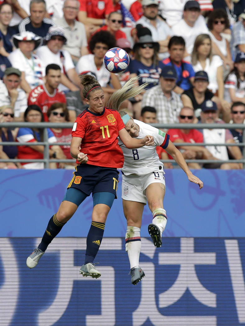 Spain's Alexia Putellas, left, challenges for the ball with United States'Julie Ertz during the ...
