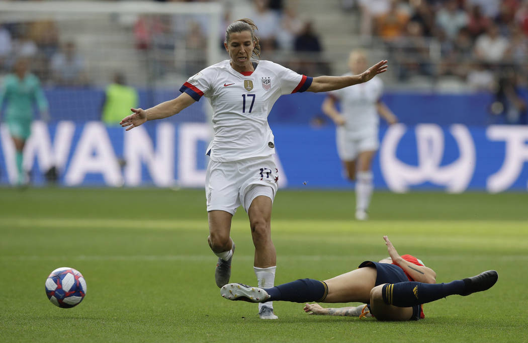 United States' Tobin Heath, left, is challenged for the ball by Spain's Maria Leon during the W ...