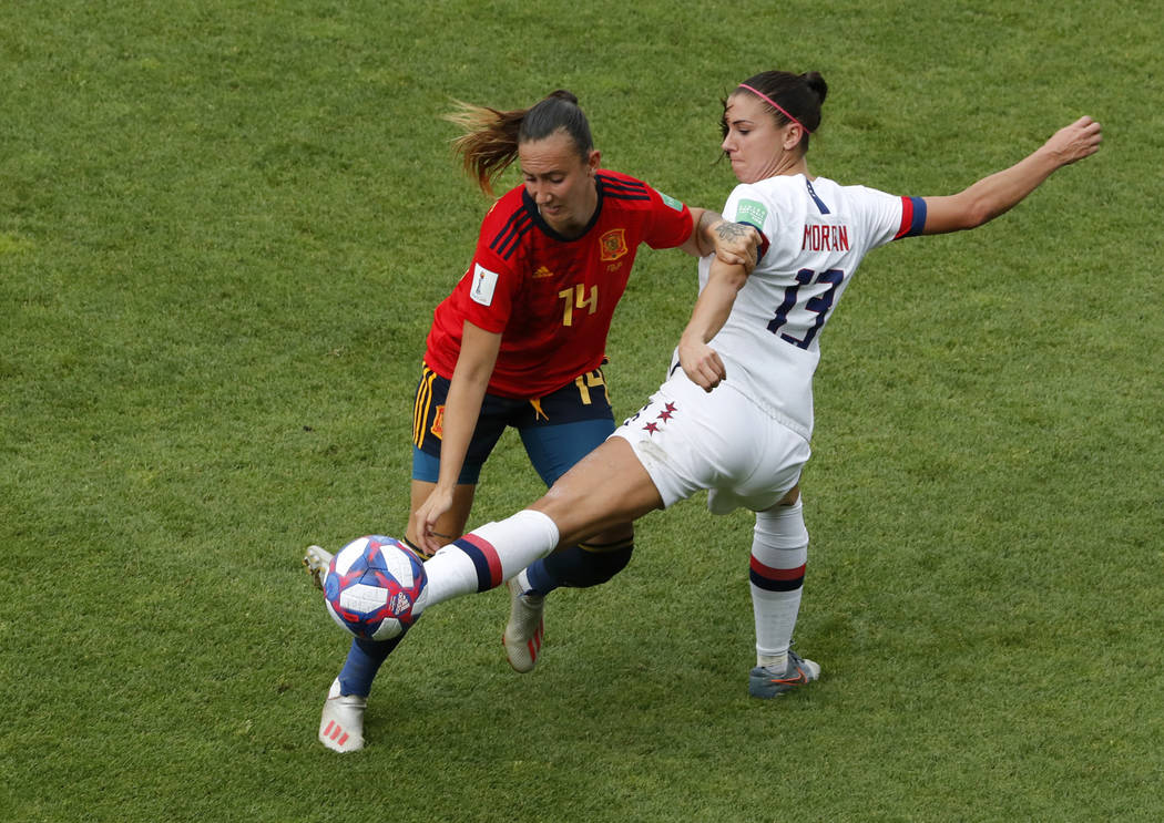 United States' Alex Morgan, right, duels for the ball with Spain's Virginia Torrecilla during t ...
