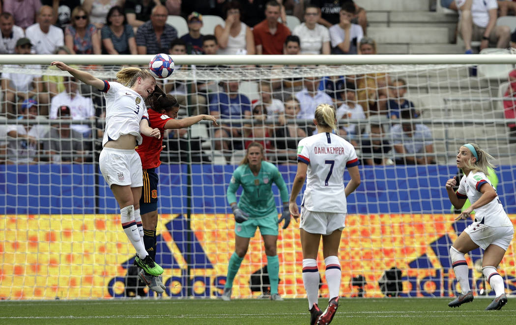 United States' Samantha Mewis, top left, jumps to defend as Spain's Patri Guijarro makes an att ...