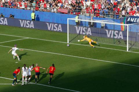 United States' Megan Rapinoe, left, scores her side's second goal from the penalty spot during ...