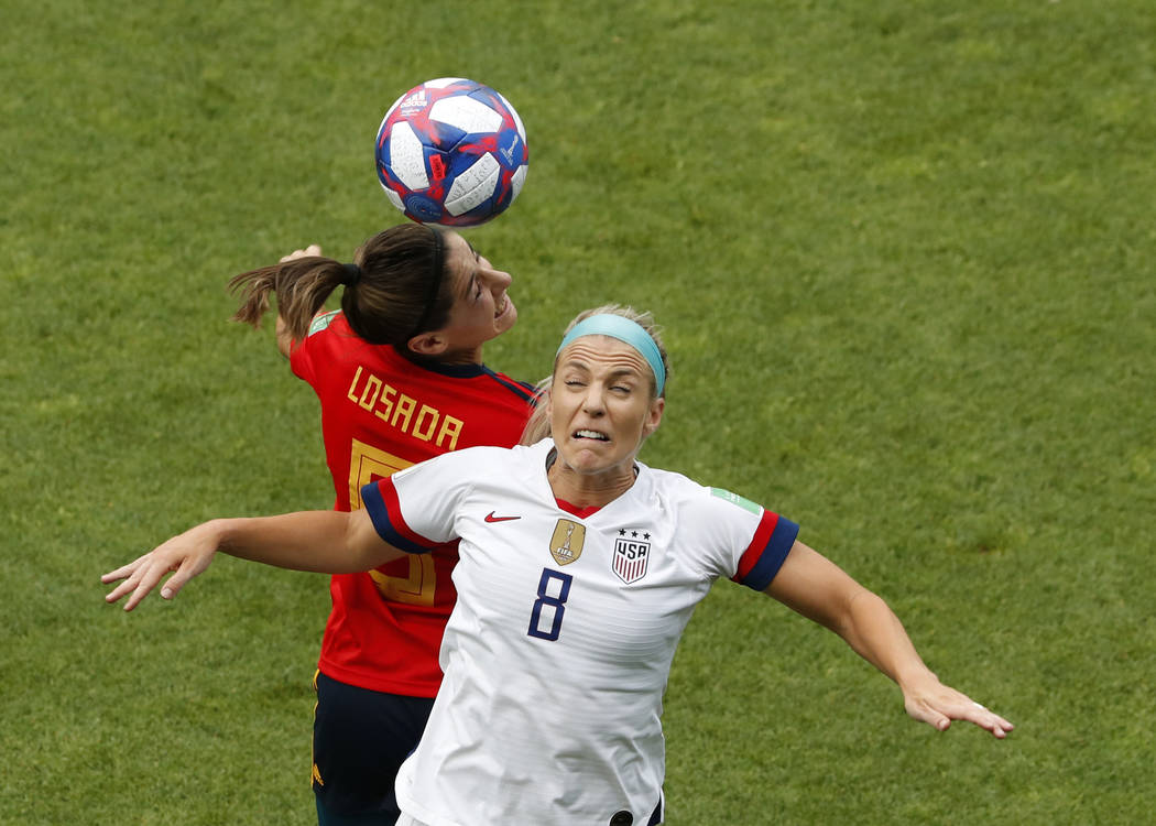 United States' Julie Ertz, right, jumps for the ball with Spain's Vicky Losada during the Women ...