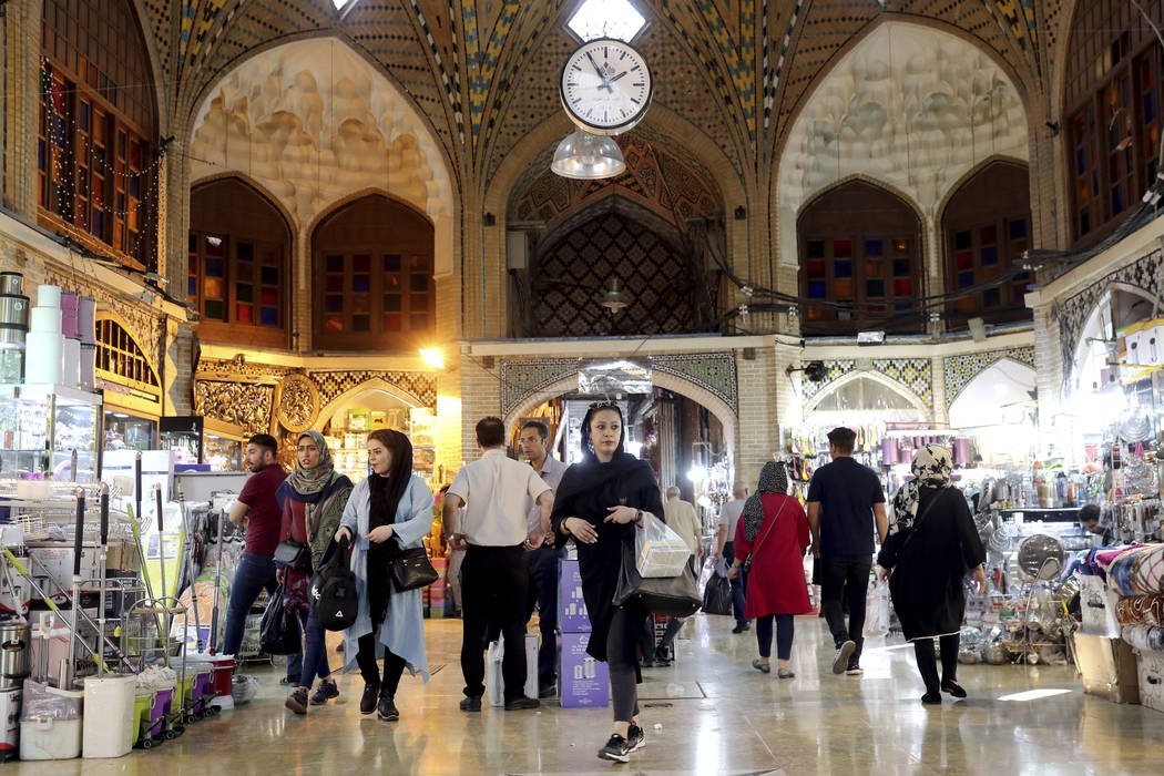 People shop at the old main bazaar in Tehran, Iran, Sunday, June 23, 2019. The most-visible pla ...