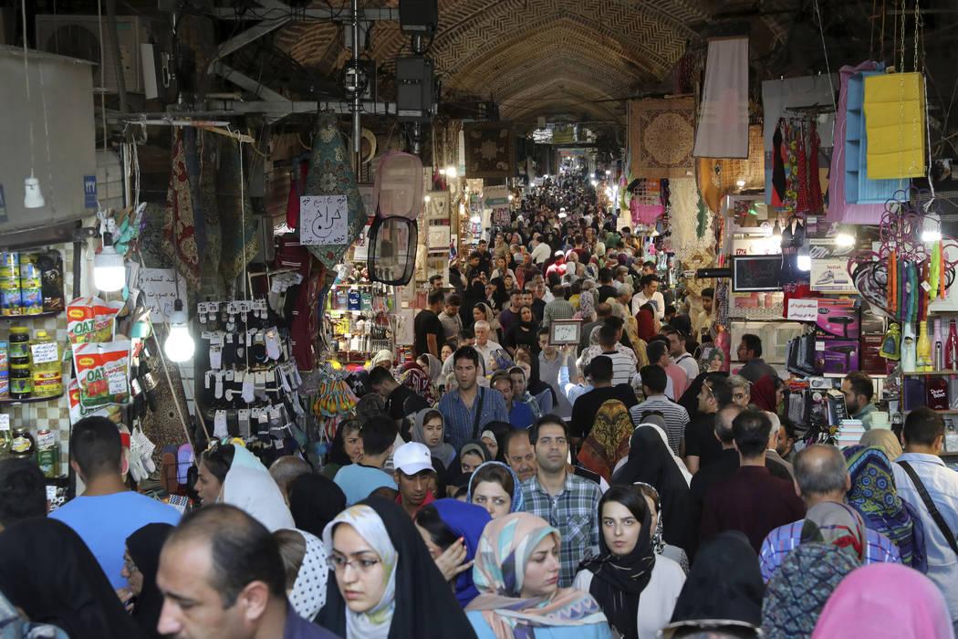 People shop at the old main bazaar in Tehran, Iran, Sunday, June 23, 2019. As the U.S. piles sa ...