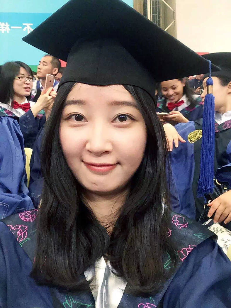 FILE - This 2016 selfie provided by her family shows Yingying Zhang in a cap and gown for her g ...
