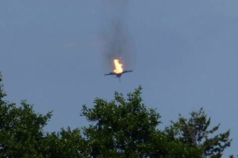 A burning Eurofighter airplane crashes down near the village Malchow in norther Germany, Monday ...